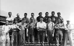 Group of men posing including Chinese workers